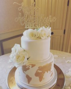 gold travel themed wedding cake